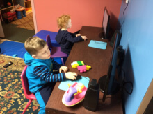 Two children using a computer